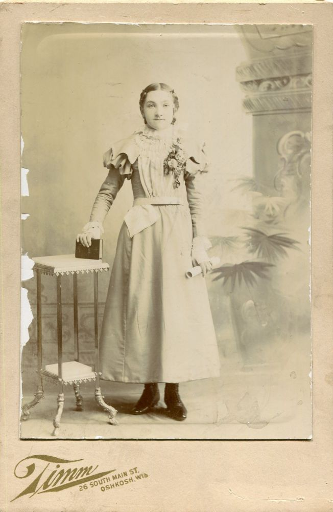 Photograph of a Girl Holding a Hymnal. Timm, G W.